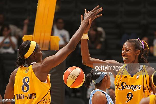 Lisa Leslie of the Los Angeles Sparks highfives DeLisha MiltonJones of the Los Angeles Sparks during the game against the Chicago Sky on June 18 2008...