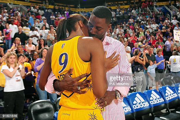 Lisa Leslie of the Los Angeles Sparks hugs husband Michael Lockwood after Game Three of the Western Conference Finals against the Phoenix Mercury...