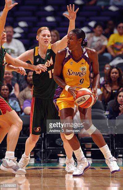 Lisa Leslie of the Los Angeles Sparks is defended by Lauren Jackson and Kamila Vodichkova of the Seattle Storm in Game two of the Western Conference...