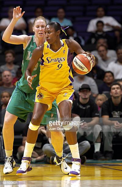 Lisa Leslie of the Los Angeles Sparks is defended by Nicole Ohlde of the Minnesota Lynx on June 18 2005 at Staples Center in Los Angeles California...