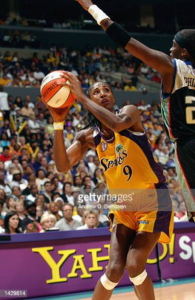 Lisa Leslie of the Los Angeles Sparks is defended by Tari Phillips of the New York Liberty during Game two of the 2002 WNBA Finals on August 31, 2002...