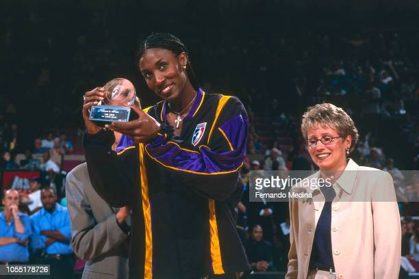 Lisa Leslie of the Los Angeles Sparks is presented with a AllWNBA selection trophy during Game One of the 2000 WNBA Finals on August 24 2000 at...