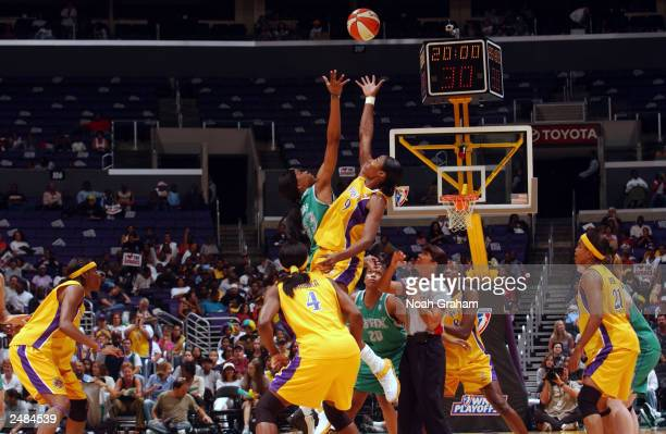 Lisa Leslie of the Los Angeles Sparks jumps for the ball against Janell Burse of the Minnesota Lynx in Game two of the Western Conference Semifinals...