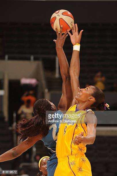 Lisa Leslie of the Los Angeles Sparks jumps for the ball against Nicky Anosike of the Minnesota Lynx on July 3 2008 at Staples Center in Los Angeles...