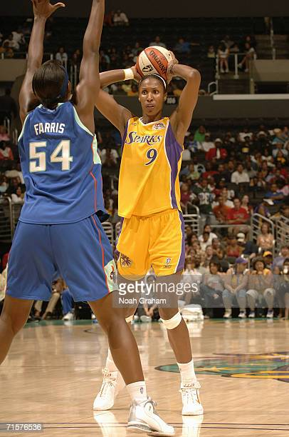 Lisa Leslie of the Los Angeles Sparks looks to make a pass play against Barbara Farris of the New York Liberty during WNBA game action at the Staples...