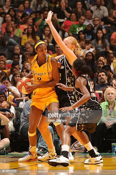Lisa Leslie of the Los Angeles Sparks looks to pass the ball around Morenike Atunrase and Ann Wauters of the San Antonio Silver Stars during the game...