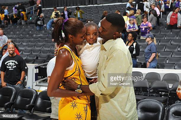 Lisa Leslie of the Los Angeles Sparks meets with husband Michael Lockwood and their daughter Lauren following the game against the Washington Mystics...