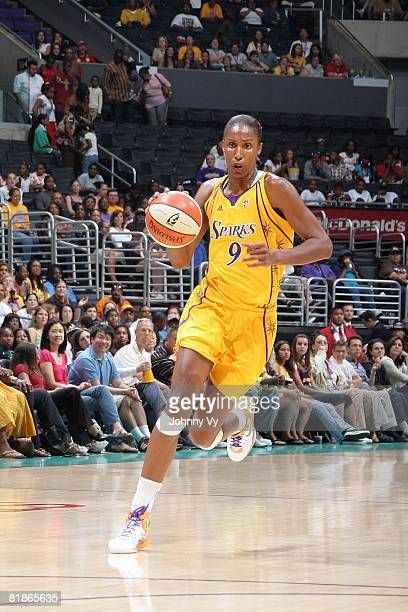 Lisa Leslie of the Los Angeles Sparks moves the ball against the Minnesota Lynx during the game on July 3 2008 at Staples Center in Los Angeles...