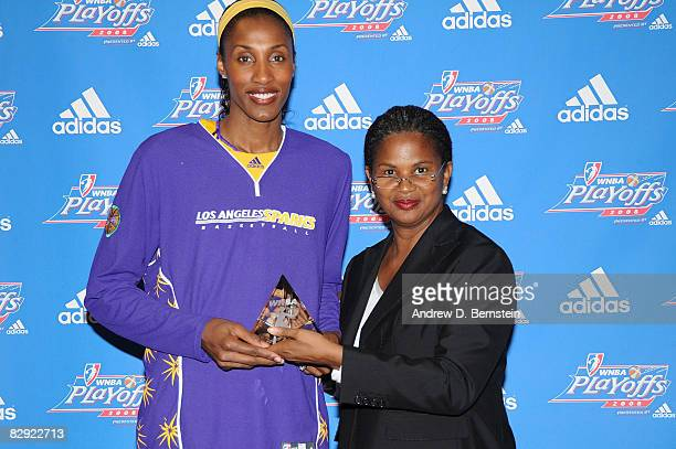 Lisa Leslie of the Los Angeles Sparks poses for a photo while holding her Defensive Player of the Year Award with Renee Brown Chief of Basketball...