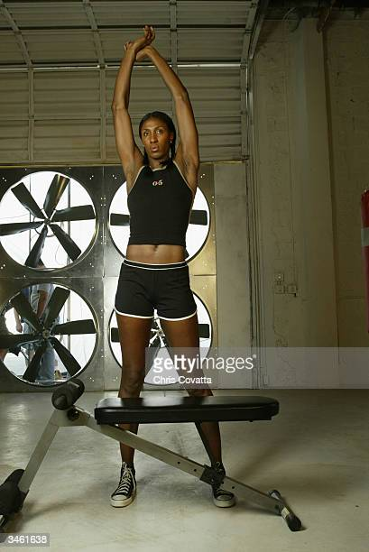 Lisa Leslie of the Los Angeles Sparks poses for a portrait as part of the WNBA 'This Is Who I Am' campaign on March 11 2004 in Miami Florida NOTE TO...