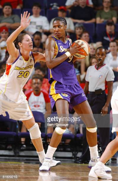 Lisa Leslie of the Los Angeles Sparks posts up Kayte Christensen of the Phoenix Mercury in a WNBA game played on September 8 2004 at America West...