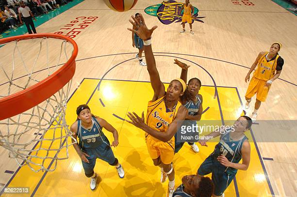 Lisa Leslie of the Los Angeles Sparks puts a shot against the defense of the Minnesota Lynx during their game at Staples Center on September 1 2008...