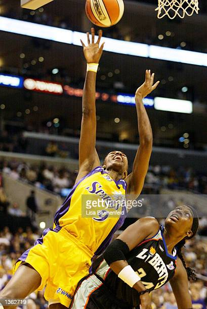 Lisa Leslie of the Los Angeles Sparks puts a shot up over Tari Phillips of the New York Liberty in game two of the 2002 WNBA Finals on August 31,...