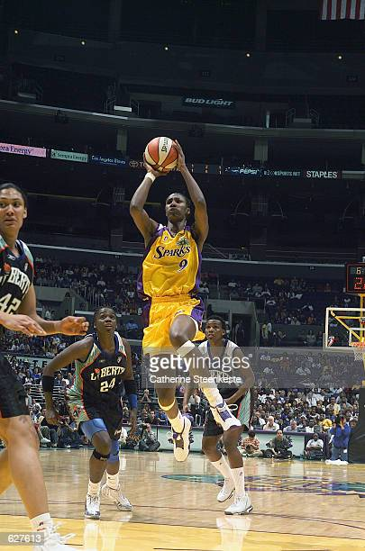 Lisa Leslie of the Los Angeles Sparks puts up a shot in the game against the New York Liberty at Staples Center in Los Angeles California on May 25...