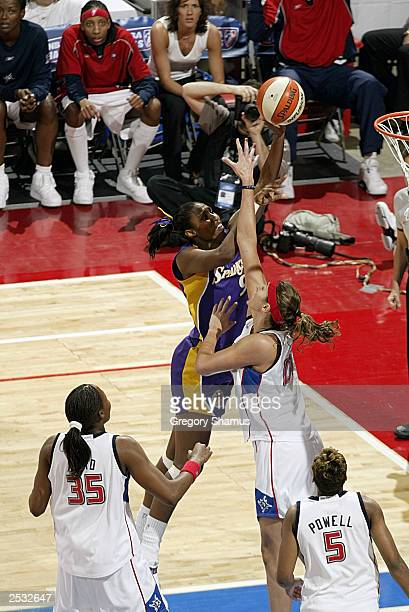 Lisa Leslie of the Los Angeles Sparks puts up a shot over Ruth Riley of the Detroit Shock in Game three of the 2003 WNBA Finals on September 16 2003...