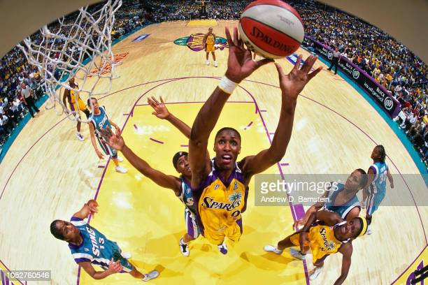 Lisa Leslie of the Los Angeles Sparks rebounds during Game Two of the 2001 WNBA Finals on September 1 2001 at the Staples Center in Los Angeles...