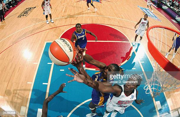 Lisa Leslie of the Los Angeles Sparks rebounds over Barbara Farris of the Detroit Shock during game two of the 2003 WNBA Finals at the Palace of...