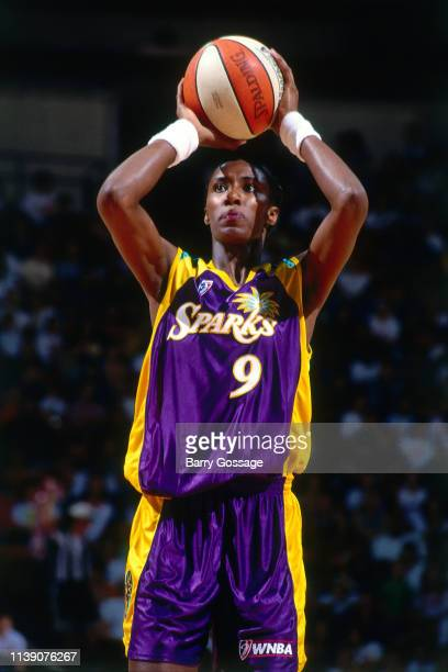 Lisa Leslie of the Los Angeles Sparks shoots a free throw against the Phoenix Mercury on June 14 1997 at America West Arena in Phoenix Arizona NOTE...