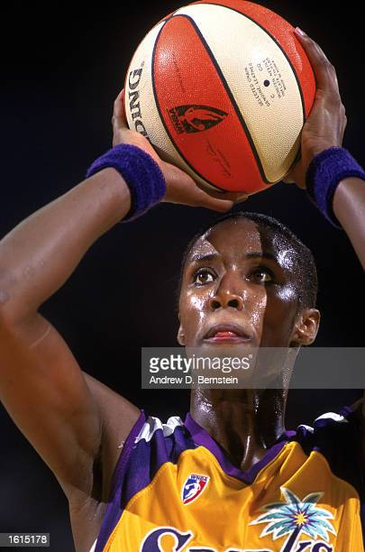 Lisa Leslie of the Los Angeles Sparks shoots a free throw during the inaugural WNBA game against the New York Liberty at the Great Western Forum on...
