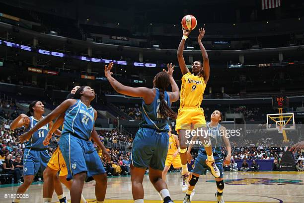 Lisa Leslie of the Los Angeles Sparks shoots against Charde Houston of the Minnesota Lynx during their game on July 3 2008 at Staples Center in Los...