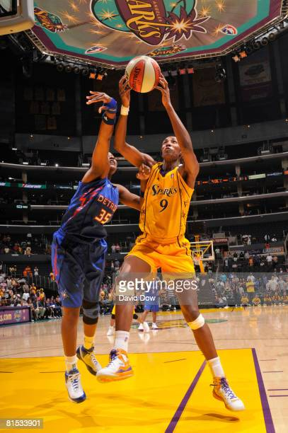 Lisa Leslie of the Los Angeles Sparks shoots against Cheryl Ford of the Detroit Shock during their game at Staples Center on June 11 2008 in Los...