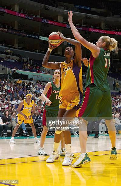 Lisa Leslie of the Los Angeles Sparks shoots against Lauren Jackson of the Seattle Storm during the game at Staples Center on June 1 2004 in Los...