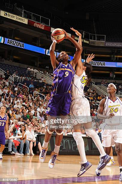 Lisa Leslie of the Los Angeles Sparks shoots against Tangela Smith of the Phoenix Mercury on July 17 at US Airways Center in Phoenix Arizona NOTE TO...