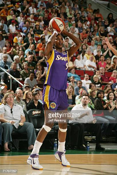 Lisa Leslie of the Los Angeles Sparks shoots against the Seattle Storm during game one of the first round on August 18 2006 at Key Arena in Seattle...