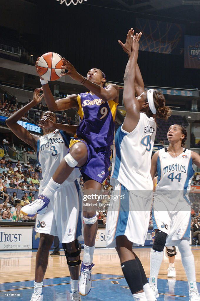 Lisa Leslie #9 of the Los Angeles Sparks shoots against Washington Mystics DeLisha Milton-Jones #3 and Nakia Sanford #43 during the game on August 1, 2006 at MCI Center in Washington, D.C. The Mystics won 84-74.