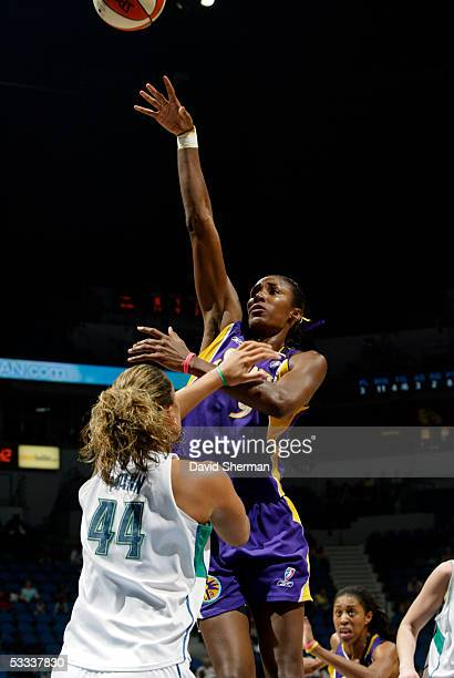Lisa Leslie of the Los Angeles Sparks shoots over Kristen Mann of the Minnesota Lynx on August 7 2005 at the Target Center in Minneapolis Minnesota...