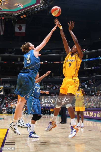Lisa Leslie of the Los Angeles Sparks shoots over Nicole Ohlde of the Minnesota Lynx on July 3 2008 at Staples Center in Los Angeles California NOTE...