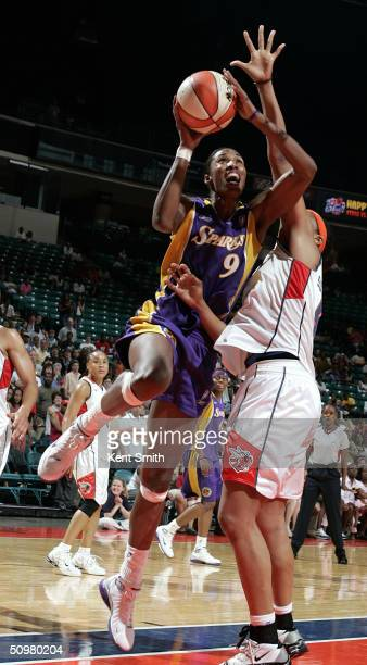 Lisa Leslie of the Los Angeles Sparks shoots over Tammy SuttonBrown of the Charlotte Sting on June 20 2004 at the Charlotte Coliseum in Charlotte...