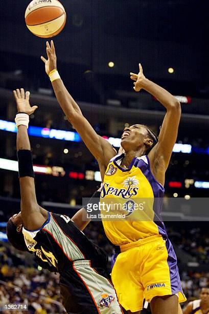 Lisa Leslie of the Los Angeles Sparks shoots over Tari Phillips of the New York Liberty in game two of the 2002 WNBA Finals on August 31, 2002 at...