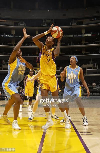 Lisa Leslie of the Los Angeles Sparks shoots the ball past Bernadette Ngoyisa and Jia Perkins of the Chicago Sky at the Staples Center on June 9 2006...
