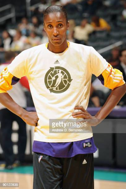 Lisa Leslie of the Los Angeles Sparks stands on the court during pregame warmups wearing a recycle logo tshirt supporting the 'Go Green Night' prior...