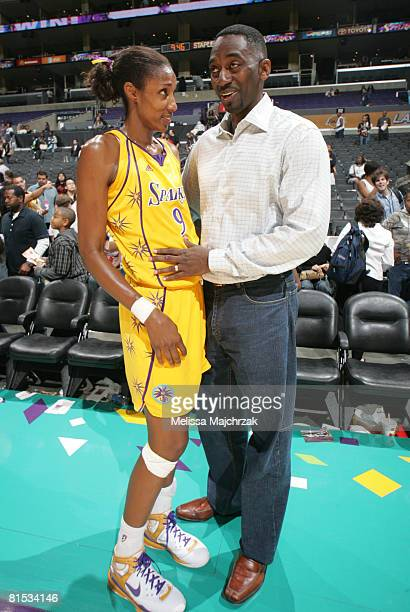 Lisa Leslie of the Los Angeles Sparks stands with husband Michael Lockwood following her team's victory over the Detroit Shock at Staples Center on...
