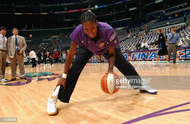 Lisa Leslie of the Los Angeles Sparks stretches before Game two of the 2002 WNBA Finals against the New York Liberty on August 31 2002 at Staples...