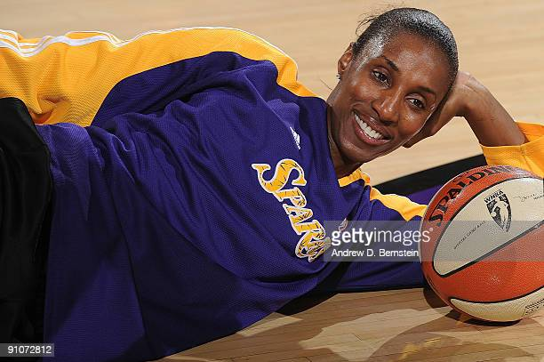 Lisa Leslie of the Los Angeles Sparks stretches in warmups prior to the Game One of the Western Conference Finals against the Phoenix Mercury during...