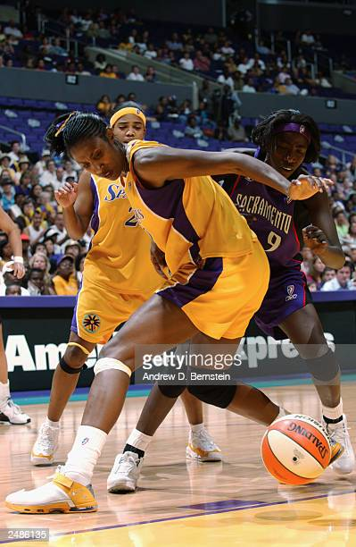 Lisa Leslie of the Los Angeles Sparks struggles for the ball against Hamchetou Maiga of the Sacramento Monarchs in Game two of the Western Conference...