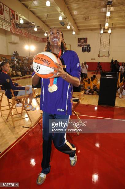 Lisa Leslie of the Los Angeles Sparks take the first shot on the new floor after being refurbished under the Project Rebound program on August 27...