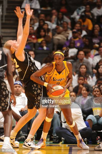 Lisa Leslie of the Los Angeles Sparks tries to get around Ann Wauters of the San Antonio Silver Stars during the game at Staples Center July 14 2008...