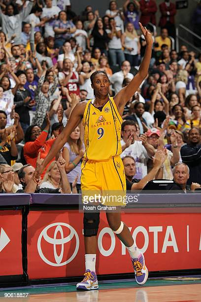 Lisa Leslie of the Los Angeles Sparks waves to the fans after exiting the game against the Minnesota Lynx on September 11 2009 at Staples Center in...