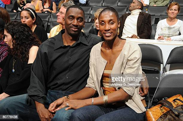 Lisa Leslie of the Los Angeles Sparks with husband Michael Lockwood pose for a photo during the game between the Dallas Mavericks and the Los Angeles...