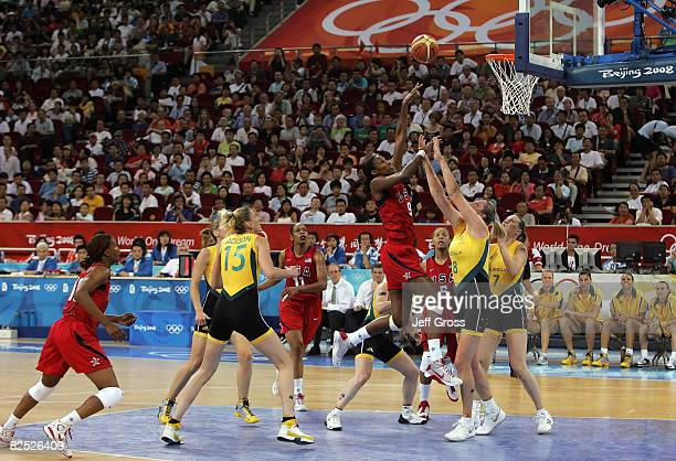 Lisa Leslie of the United States shoots the ball over Suzy Batkovic of Australia during the women's basketball gold medal game at the Beijing Olympic...