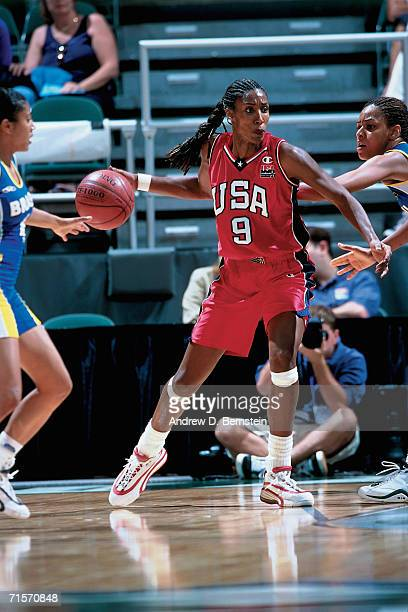 Lisa Leslie of the United States Women's National Team posts up against the Brazilian Women's National Team during the 1999-2000 pre-Olympic...
