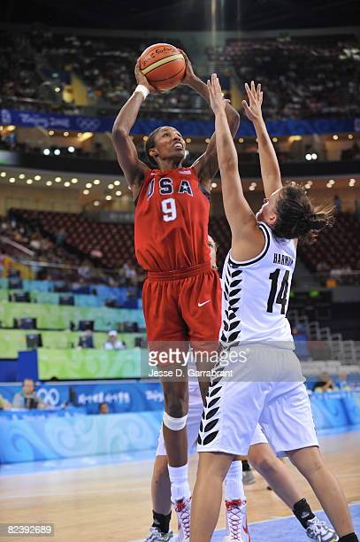 Lisa Leslie of the U.S. Women's Senior National Team shoots against Jillian Harmon of New Zealand during the women's preliminary round group B...