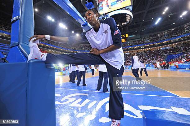 Lisa Leslie of the U.S. Women's Senior National Team stretches against New Zealand during the women's preliminary round group B basketball match at...