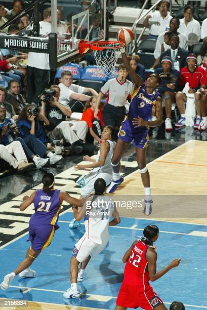 Lisa Leslie of the Western conference AllStars drives to the basket for a layup against the Western Conference during the WNBA AllStar game at...