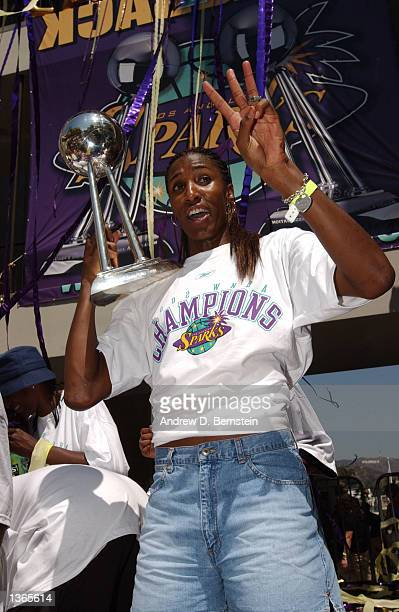 Lisa Leslie puts up three fingers in hopes of a third Championship next year The Los Angeles Sparks celebrate their Back to Back World Championships...