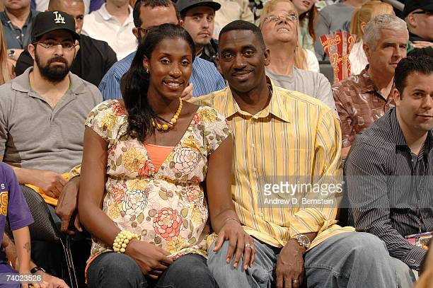 Lisa Leslie sits with husband Michael Lockwood as the Phoenix Suns play against the Los Angeles Lakers in Game Four of the Western Conference...
